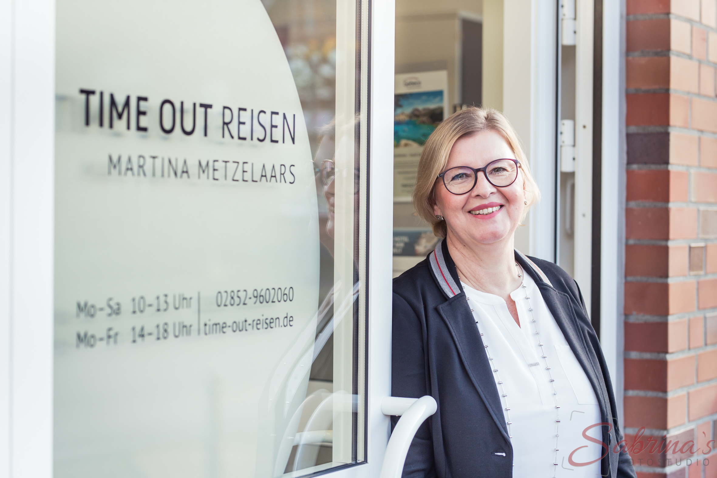 Eingangstür von Time out Reisen - Sabrina's Fotostudio in Hamminkeln, zwischen Wesel und Bocholt am Niederrhein